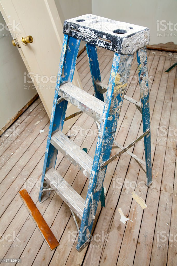 Ladder in messy renovated room stock photo