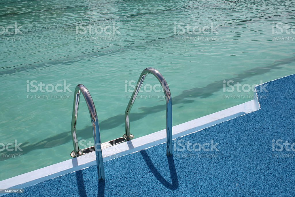 Ladder in pool stock photo