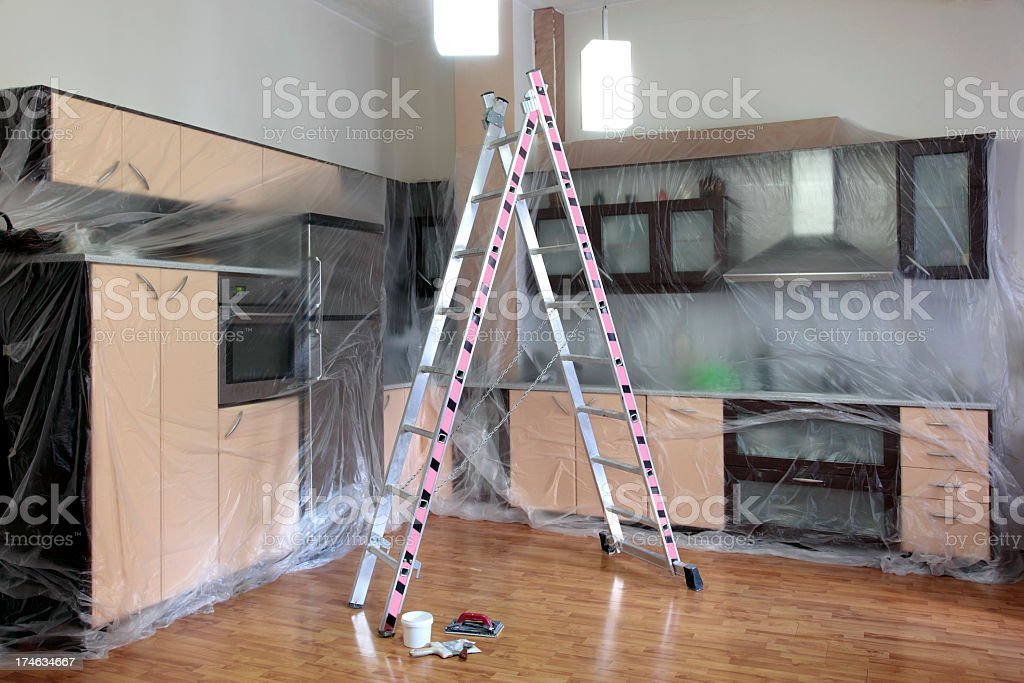 Ladder in the center of a kitchen showing home improvement royalty-free stock photo