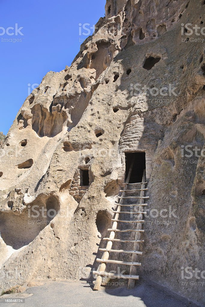 ladder into pueblo cave entrance Bandelier National Monument New royalty-free stock photo