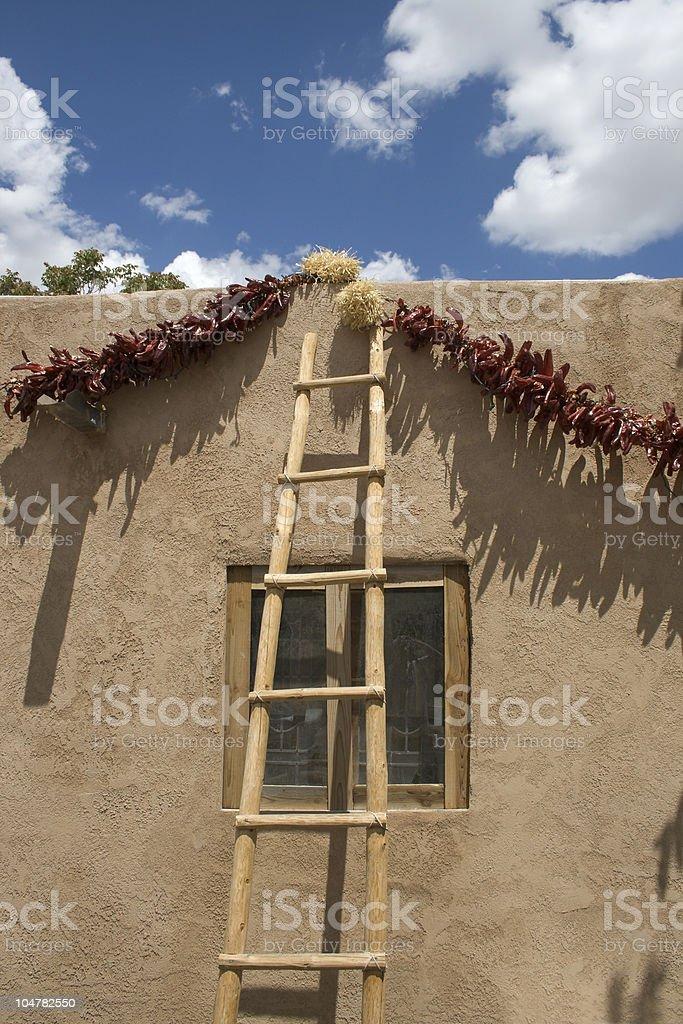 Ladder On Adobe Wall stock photo