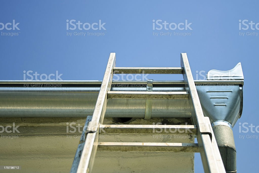 Ladder on the roof royalty-free stock photo