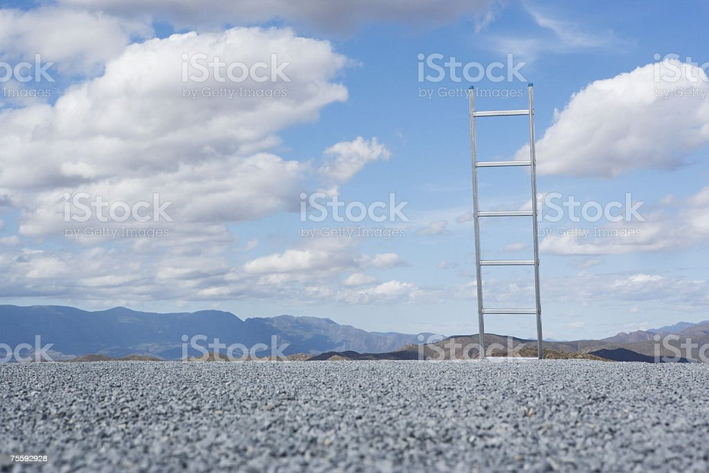 Ladder outdoors with blue sky and clouds royalty-free stock photo