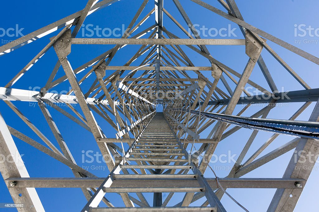 Ladder stairs of a communication tower. stock photo