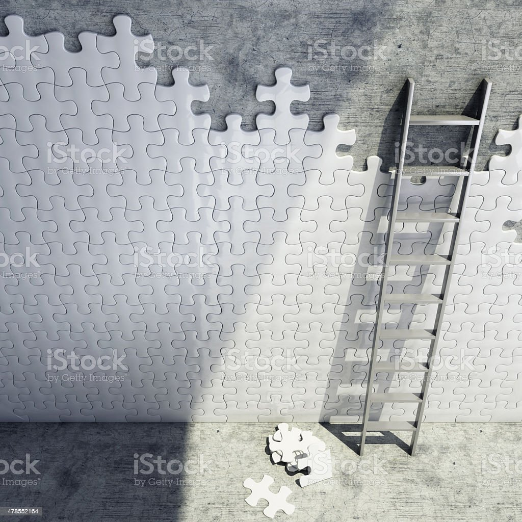 ladder with white puzzles on concrete wall stock photo