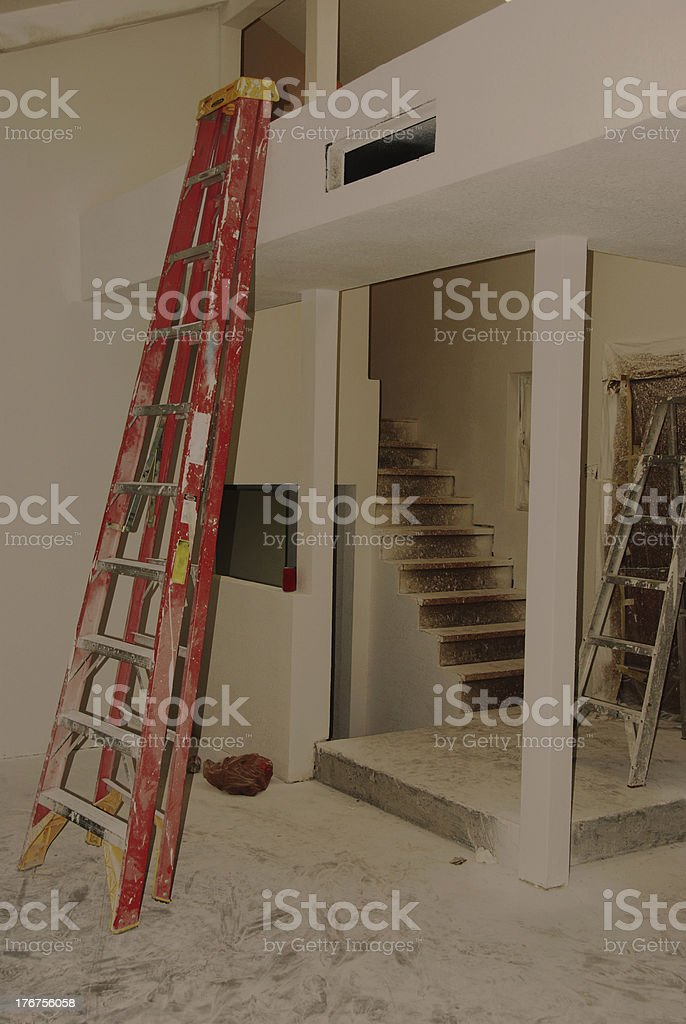 Ladders and Textured Walls in Home Improvement Project royalty-free stock photo