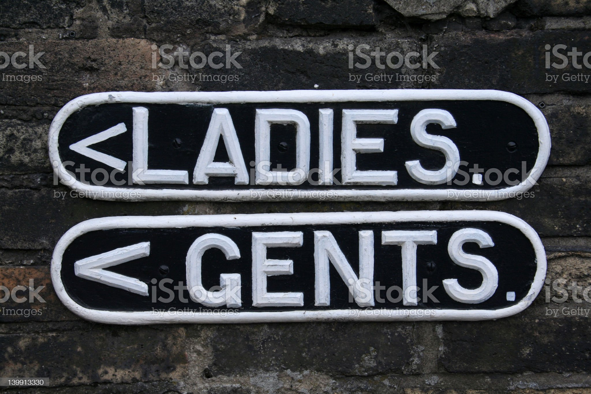 Ladies and Gents Toilet Signs royalty-free stock photo