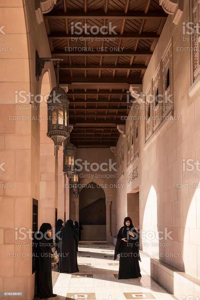 Ladies at Sultan Qaboos Grand Mosque, Muscat, Oman stock photo
