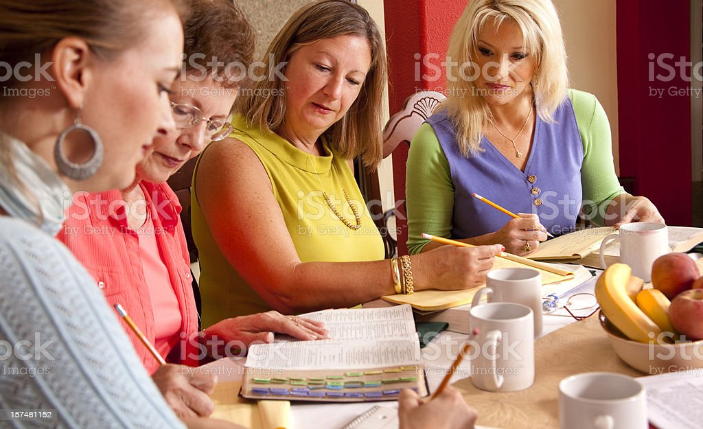 Ladies Bible Study at dining table in home stock photo