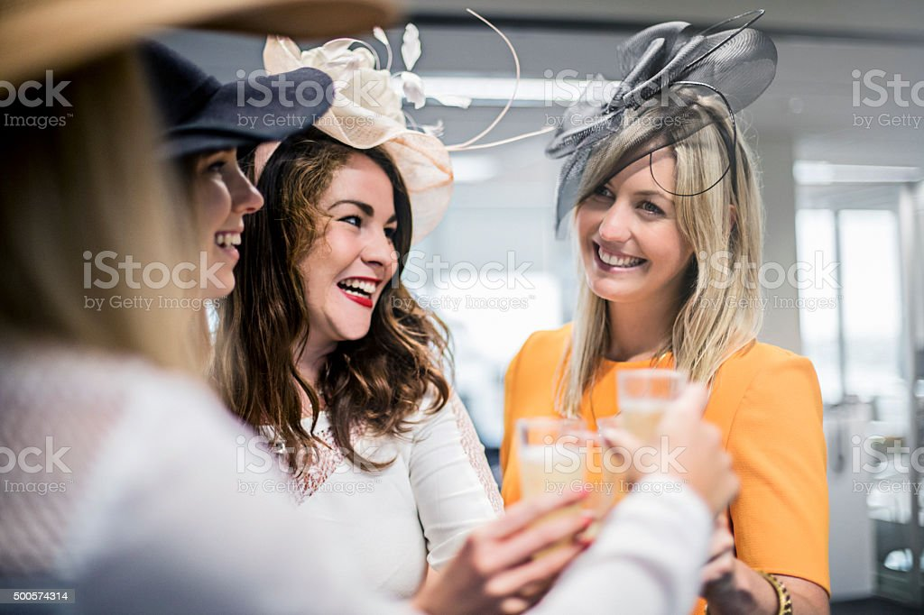 Ladies celebrating the Melbourne Cup in the offfice stock photo