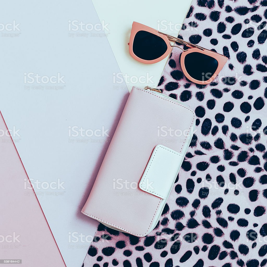 Ladies Fashion Accessories. Pink Clutch and sunglasses. Pastel c stock photo