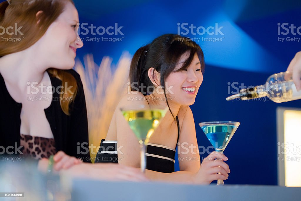 Ladies getting drinks refilled at a bar royalty-free stock photo