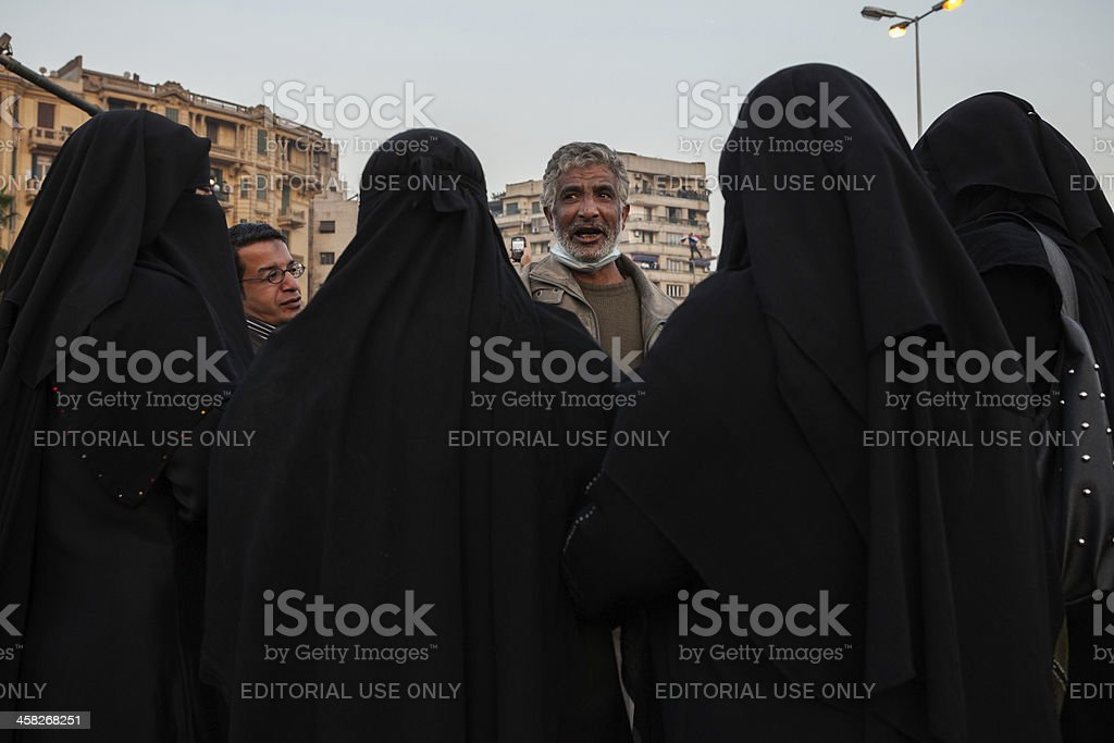 Ladies in black talking to man on Tahrir royalty-free stock photo