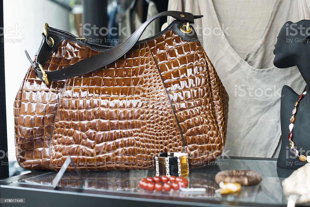 ladies leather handbag in store window stock photo