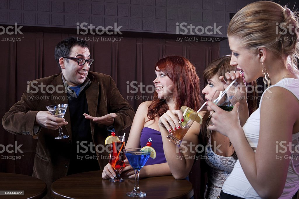 Ladies man at a nightclub stock photo