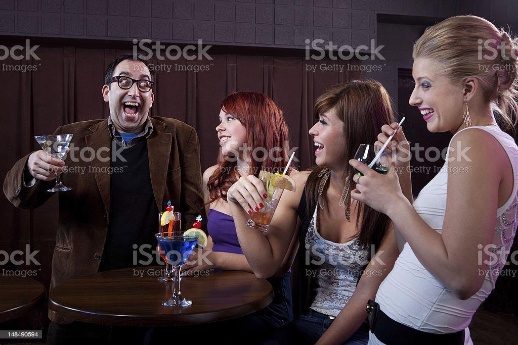 Ladies man breaking the ice at a nightclub stock photo