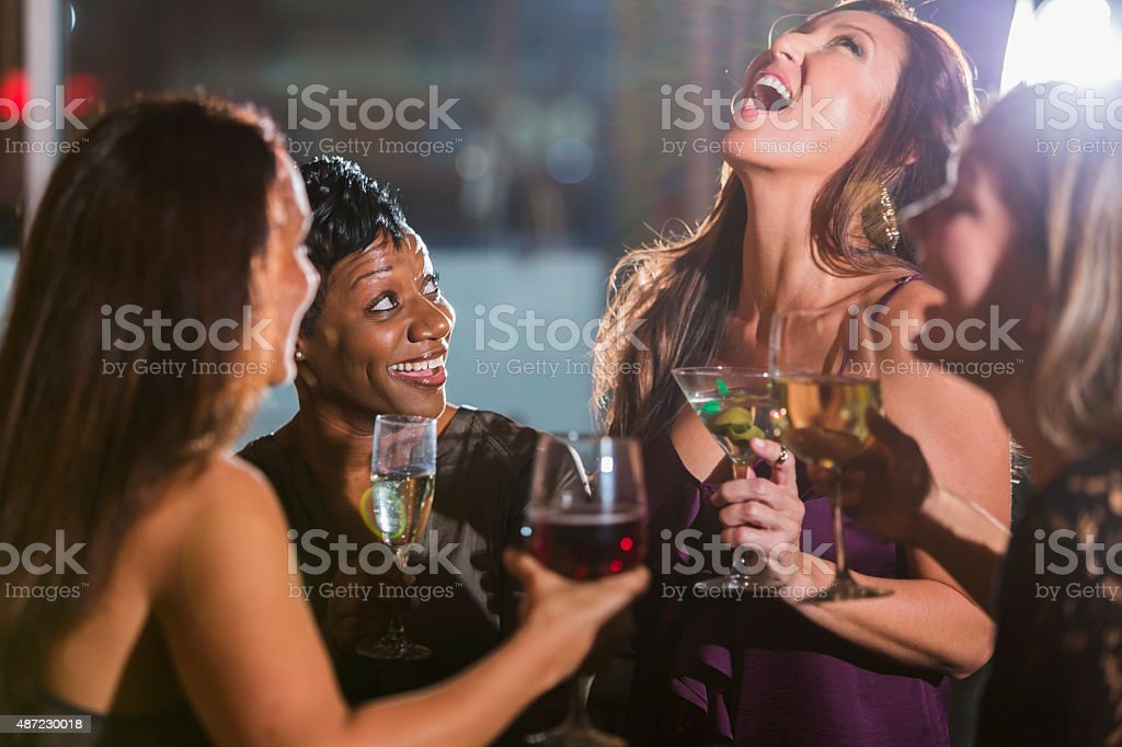 Ladies night out, having fun at a bar stock photo
