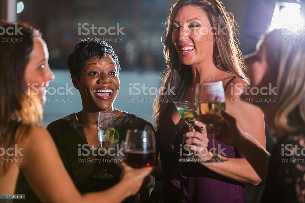 Ladies night out, having fun at a bar stock photo