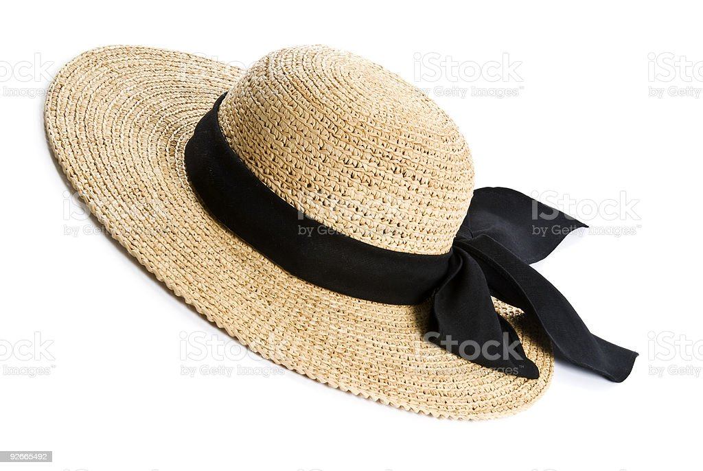 Ladies straw hat with wide brim and thick black ribbon stock photo