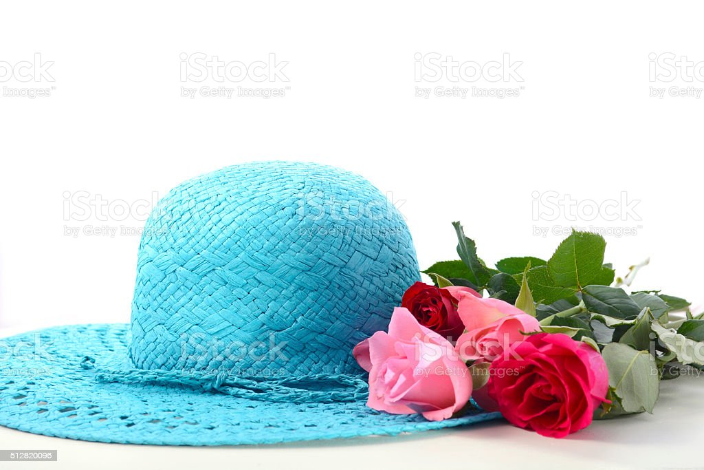 Ladies sun hat and roses stock photo