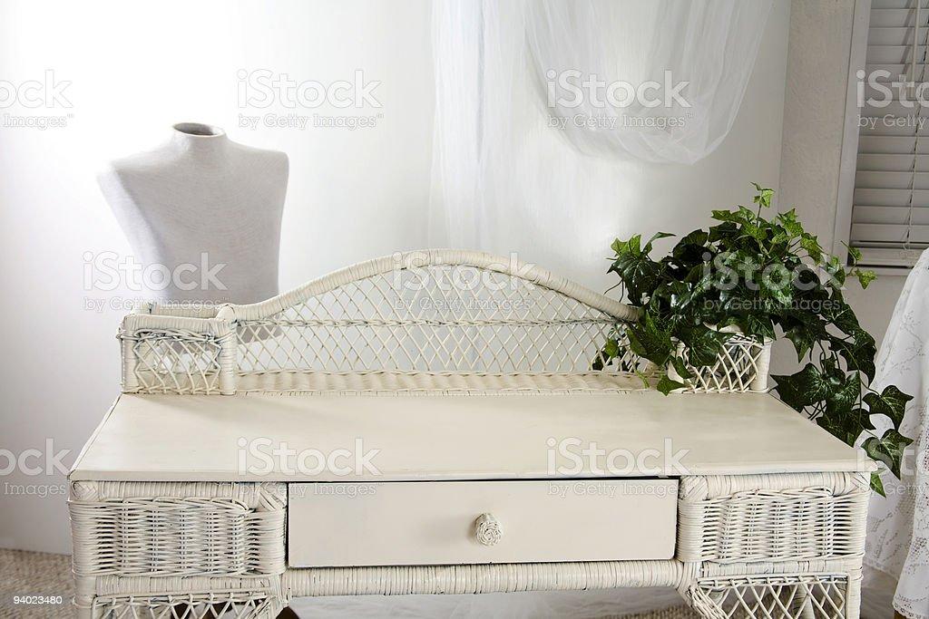 Ladies white wicker desk with open books stock photo