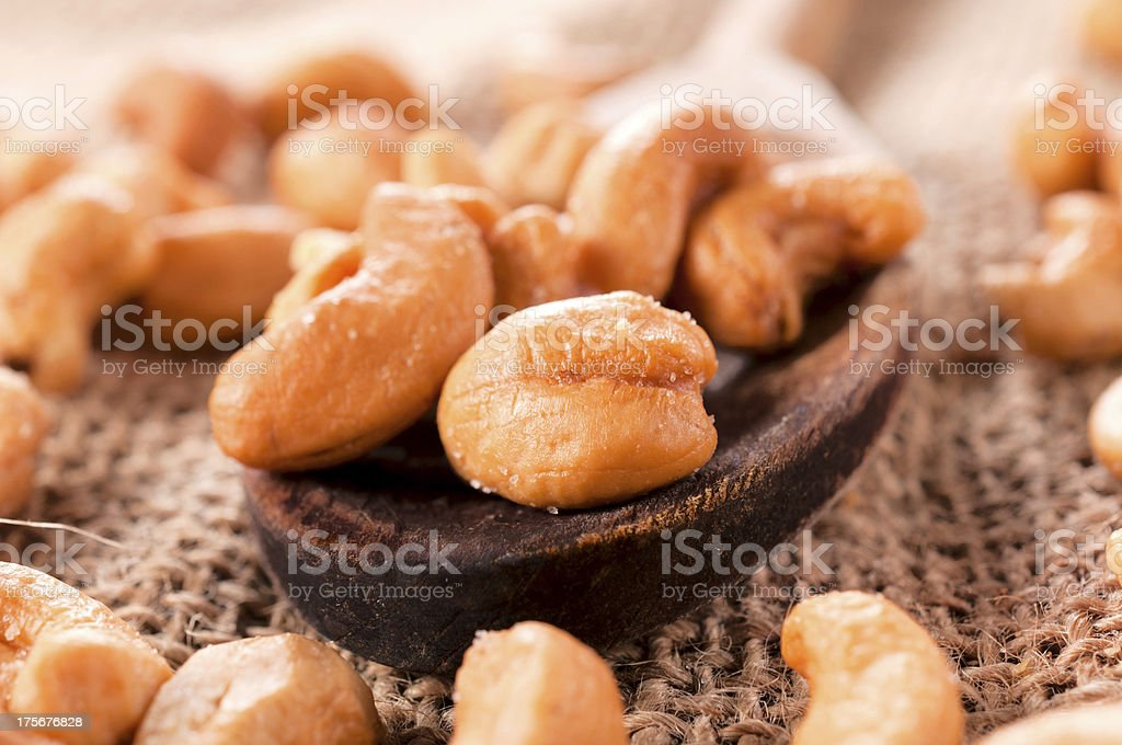 Ladle and cashew nuts royalty-free stock photo