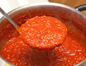 Ladle with bolognese sauce.