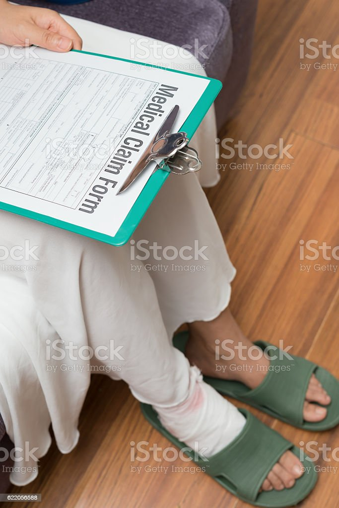 lady about to fill a medical claim form stock photo