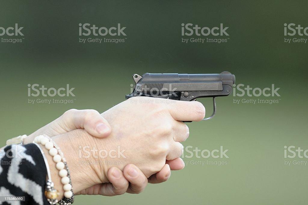 Lady aiming small pistol royalty-free stock photo