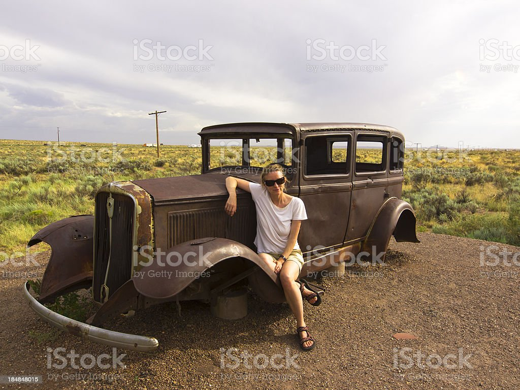 lady and  jalopy royalty-free stock photo