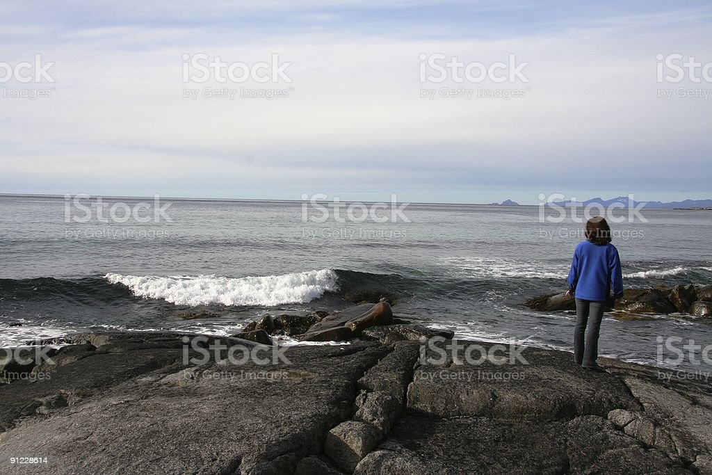 Lady and the breakers royalty-free stock photo