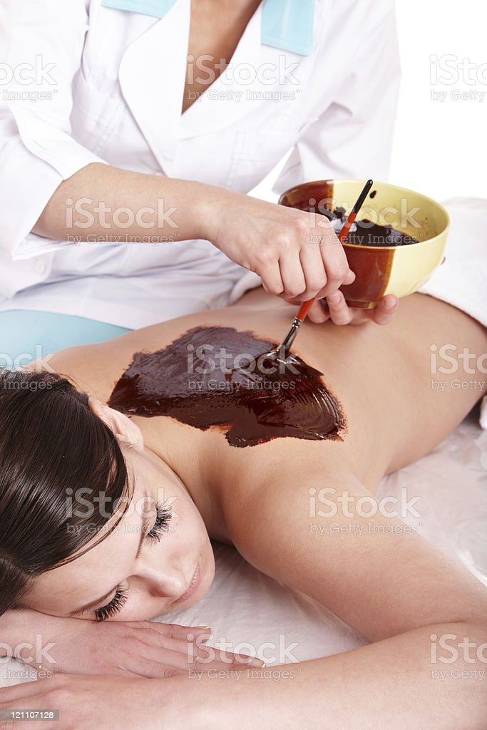 Lady being painted on by chocolate stock photo