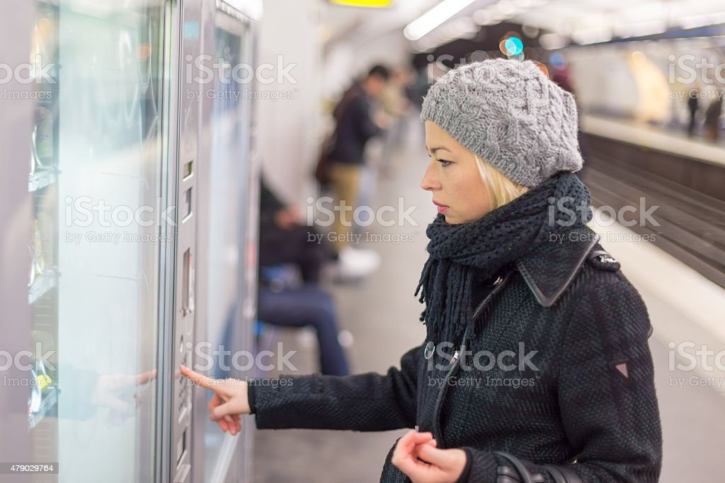 Lady buying ticket for public transport. stock photo