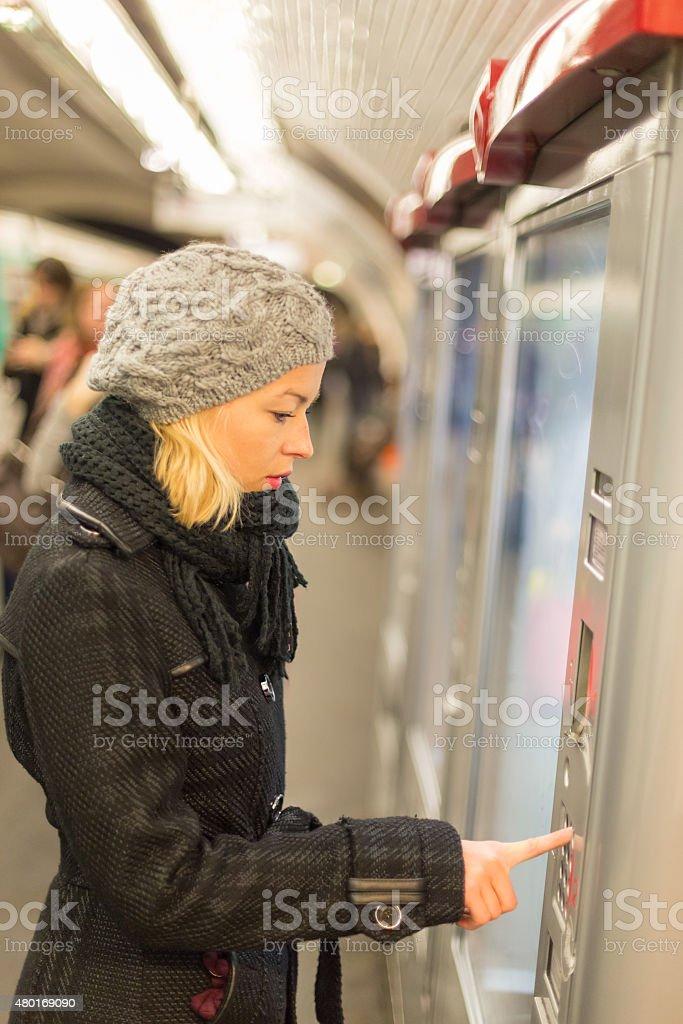 Lady buying ticket for public transport. stock photo