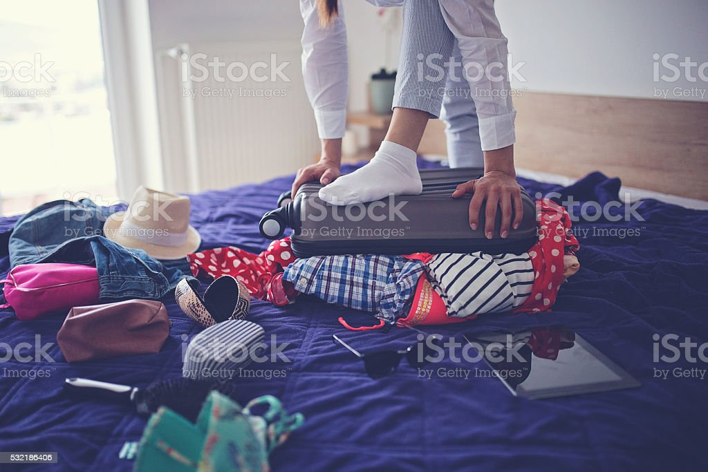 Lady can't close her bag stock photo