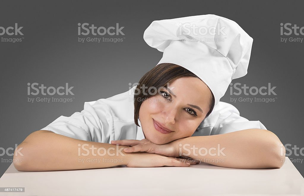 Lady chef smiling on the table stock photo
