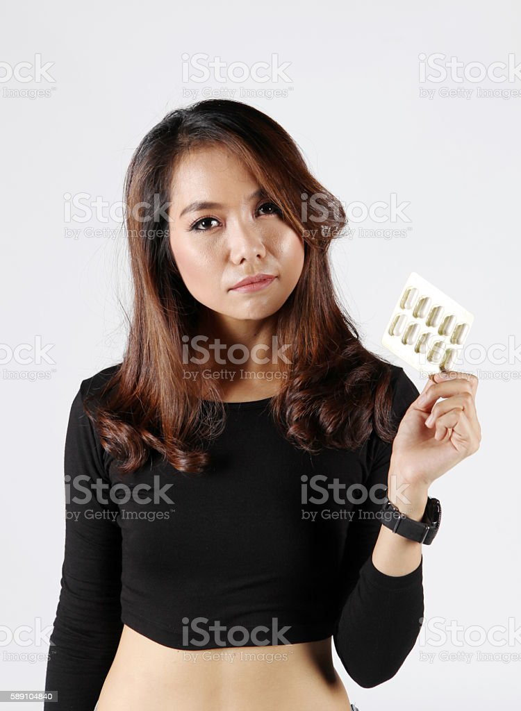 lady eat pill for fear on obesity or beauty vitamin stock photo