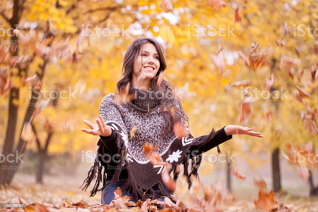 A lady enjoying the autumn season stock photo