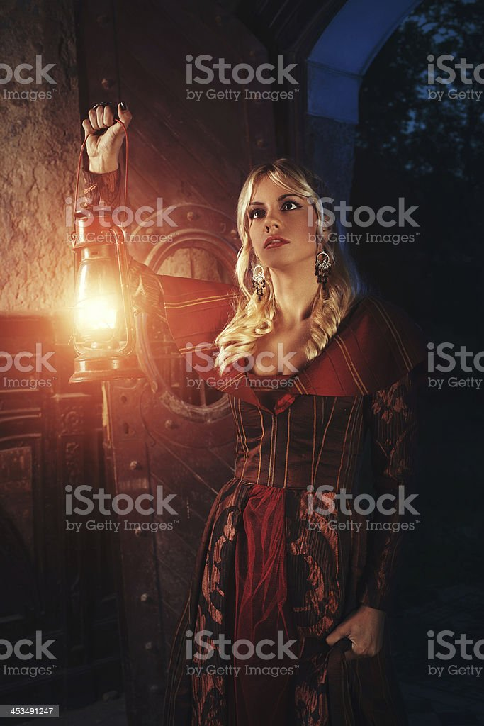 Lady explores old castle royalty-free stock photo