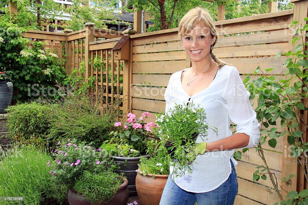 Lady gardener in the garden.. stock photo