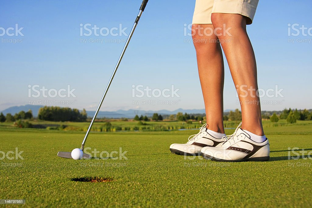 Lady golfer putt stock photo