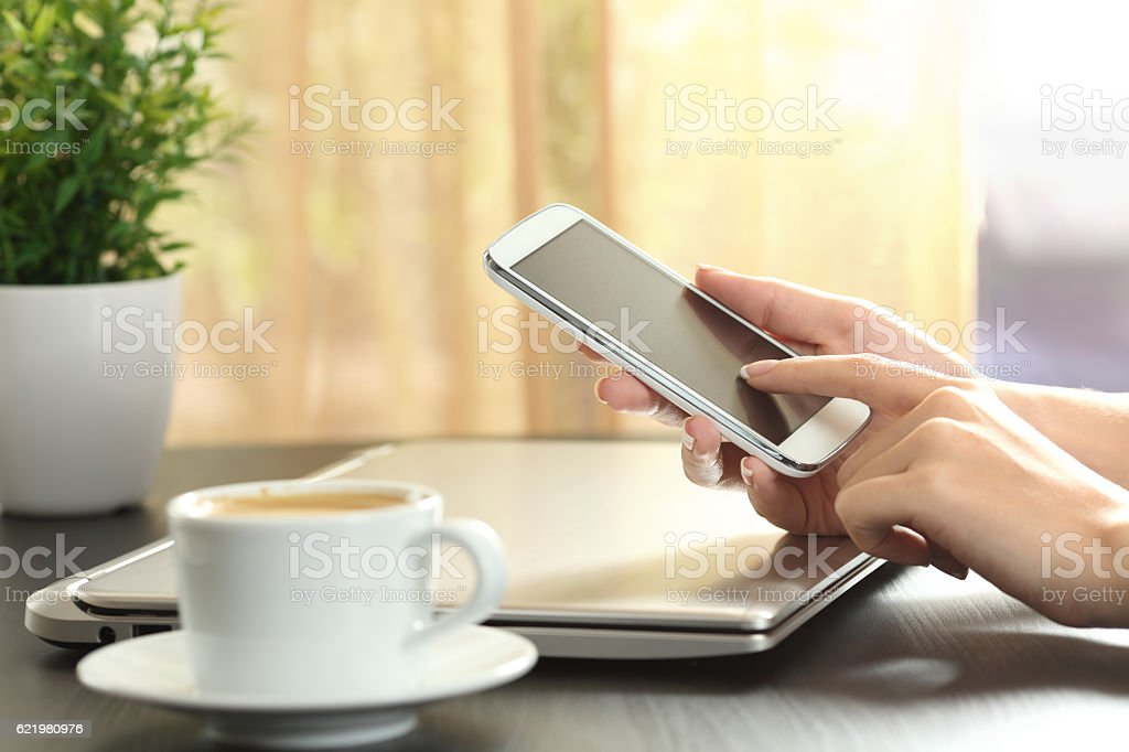 Lady hands touching a smart phone stock photo