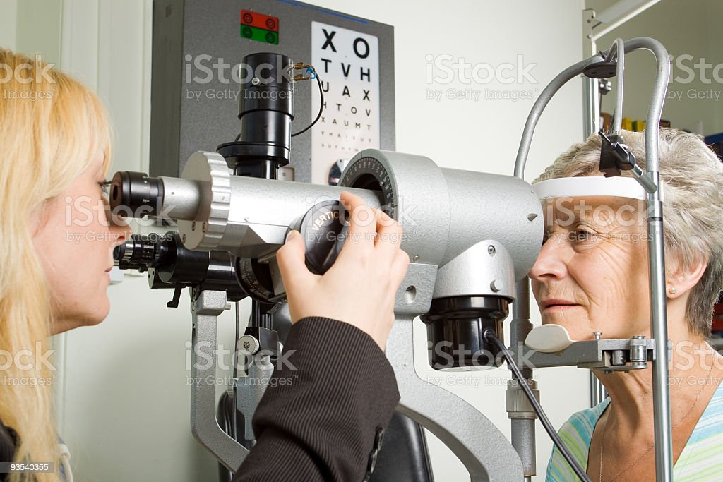 A lady having an examination test done on her eyes  stock photo