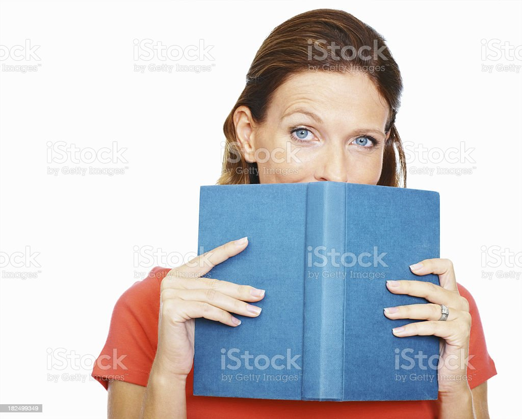 Lady hiding behind a book isolated on white background stock photo