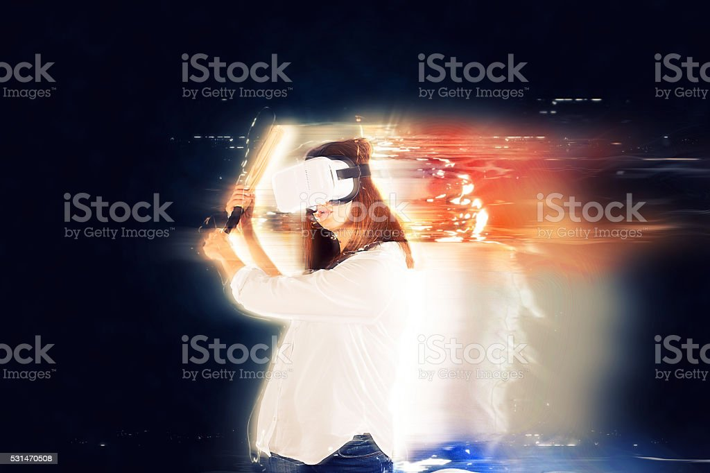 Lady holding a bat in VR stock photo