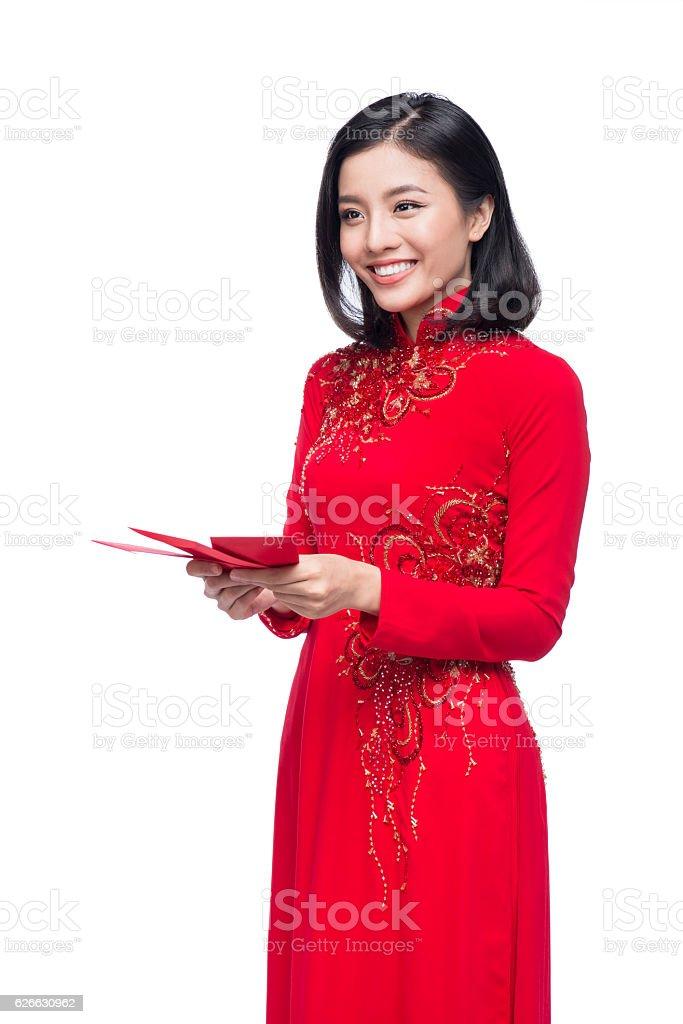Lady holding red envelopes stock photo
