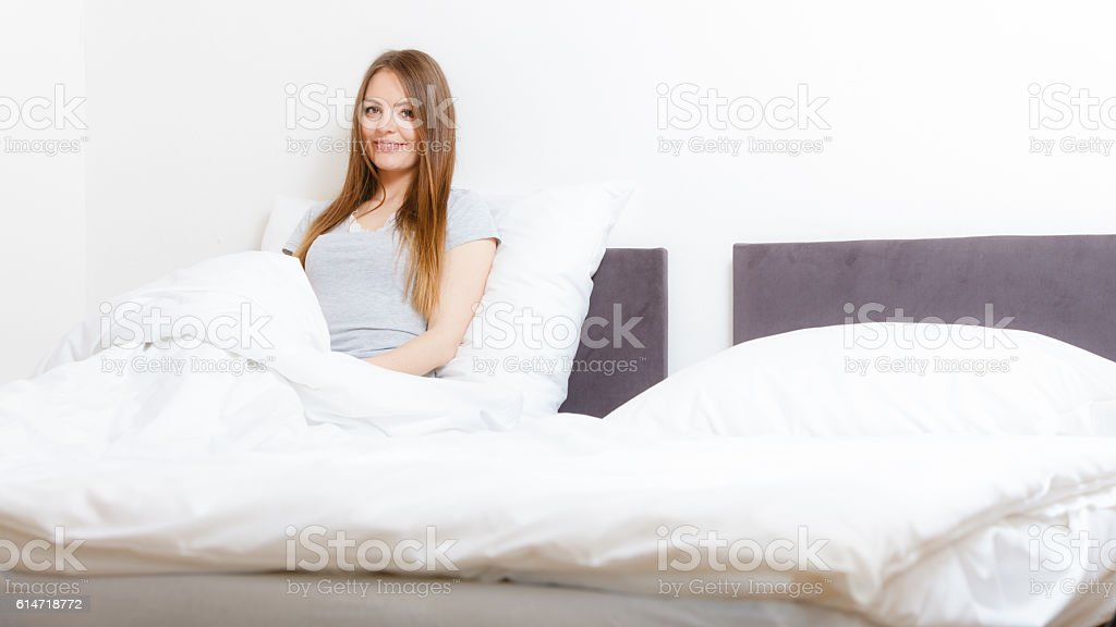 Lady in bed. stock photo