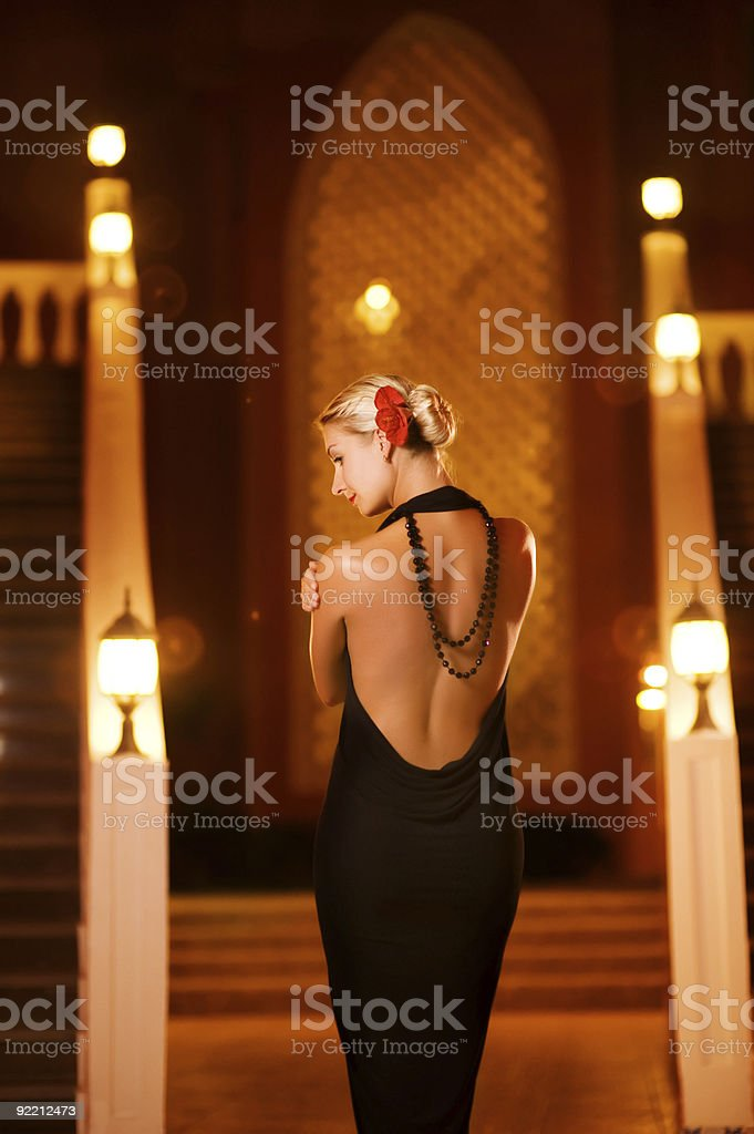 Lady in black evening dress outdoors royalty-free stock photo