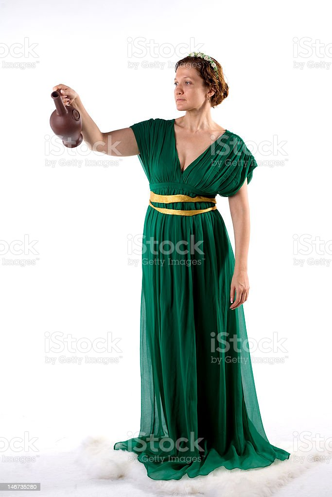 Lady in green handing jug royalty-free stock photo