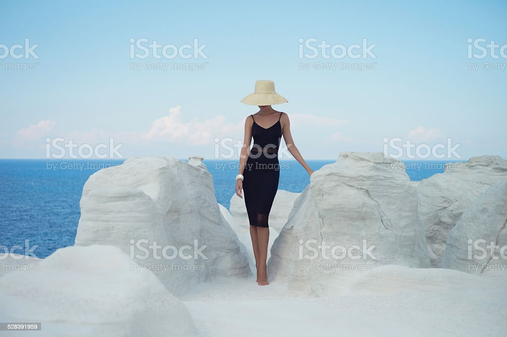 Lady in hat in an unusual landscape stock photo
